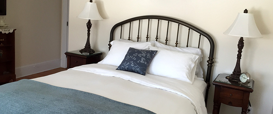 Our Traditional Guest Rooms also have wrought iron beds, and private bathrooms with a tub and shower combination